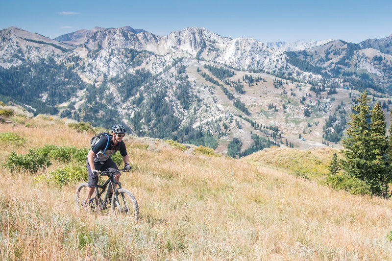 Beginning one of the many descents on the Wasatch Crest Trail with Solitude Ski Area in the background.