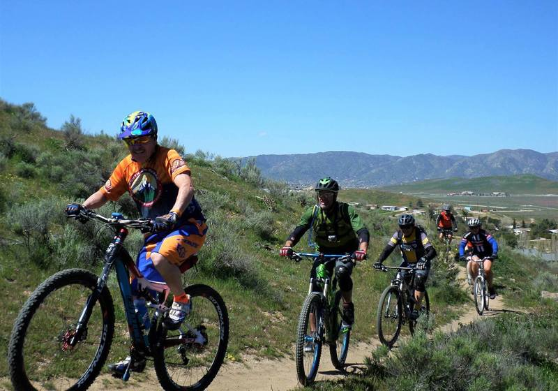 """Climbing Aimee's loop. Kevin """"Doc"""" Schmidt, Mike McCool, and Ed Zulueta in the front."""
