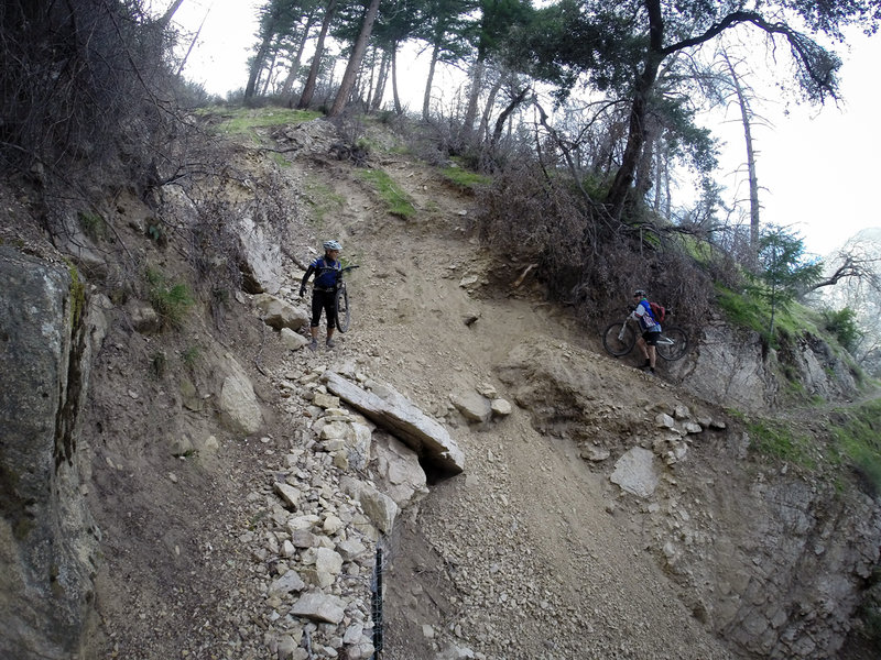 Traversing one of the slides that can happen on this trail after heavy rains.