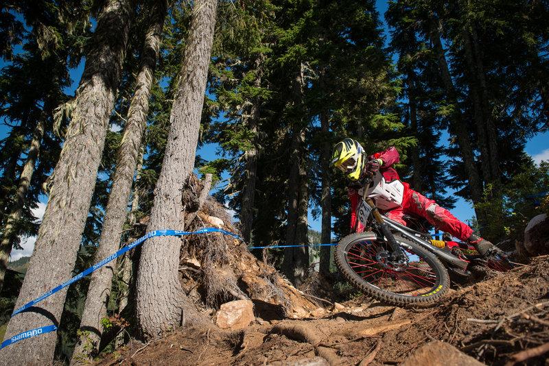 Jason Eiswald navigates a rough root section on Berserker, Stevens Pass Bike Park, WA.