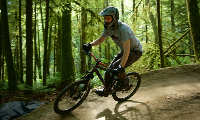 "A rider takes the high line on the dual-slalom ""Deuces Wild"" at Duthie Hill Park, WA."