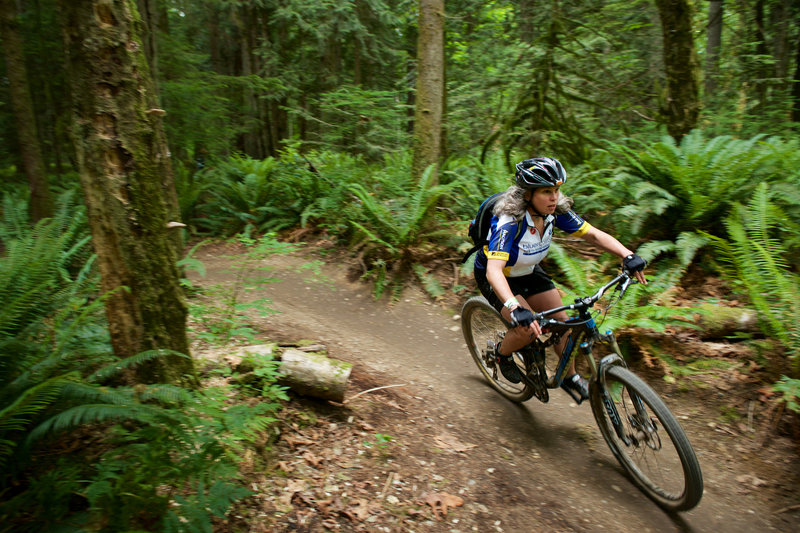 A rider enjoys the smooth berms found along Bootcamp at Duthie Bike Park, WA.