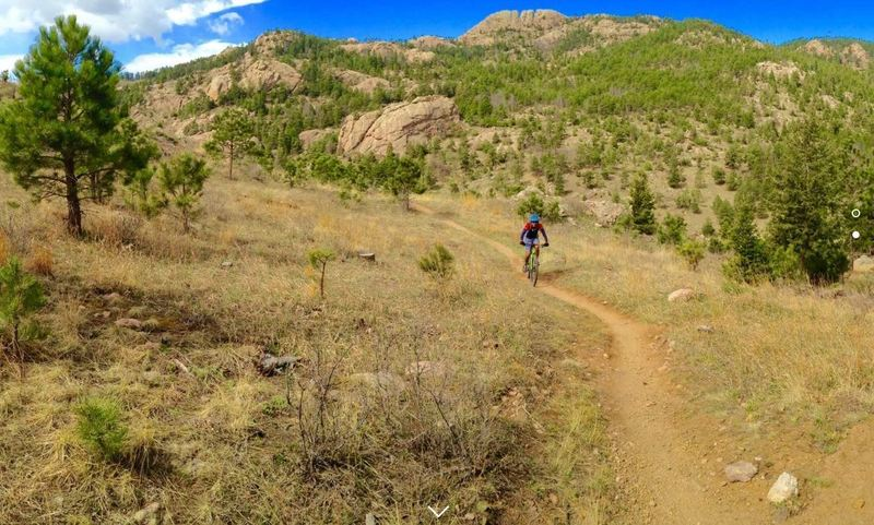 The infamous Beet Juice climbing the Herrington Trail with Horsetooth Rock in the background.