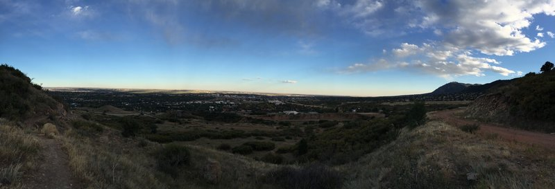 Dusk panorama of Colorado Springs to the NE. L-R you can see Pulpit Rock, Palmer Park, Bear Creek and Cheyenne Mountain.