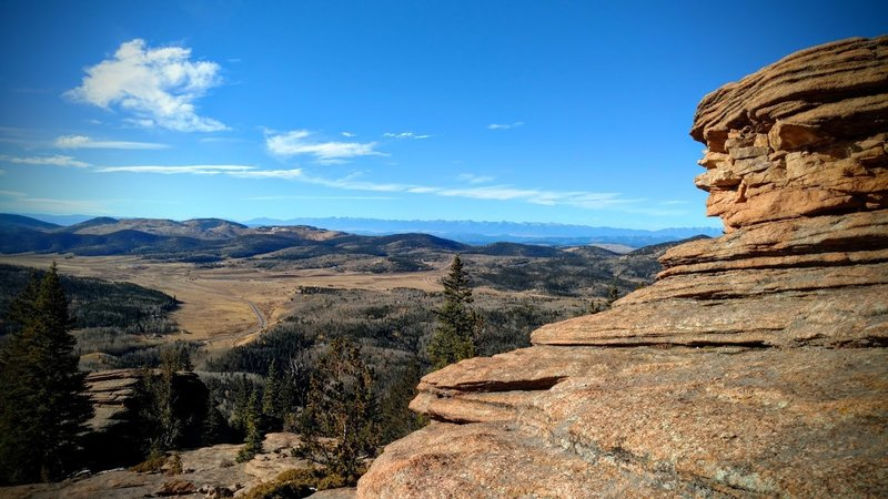Views stretch toward Cripple Creek all the way to the Sangre de Cristo range 100 miles away.