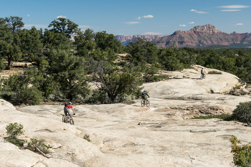 Riding down an awesome slickrock stretch on Little Creek Mesa.