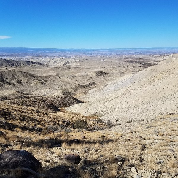 Looking out at the Adobes and Elephant Skin Road. The trail drops steeply down to the right.