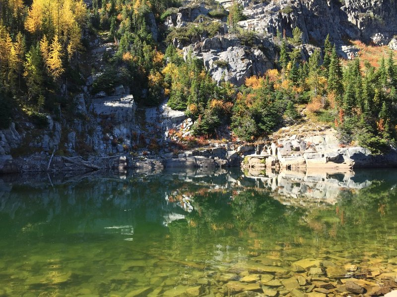 Fuse Lake shoreline with larch in fall colors.