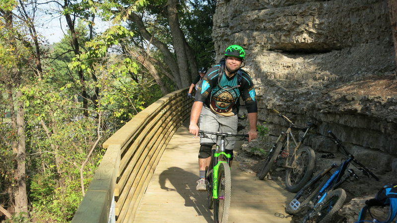 "Riding the ""Bluff Bridge"" along the trail near Hwy 71.  A great feat of trail engineering!"