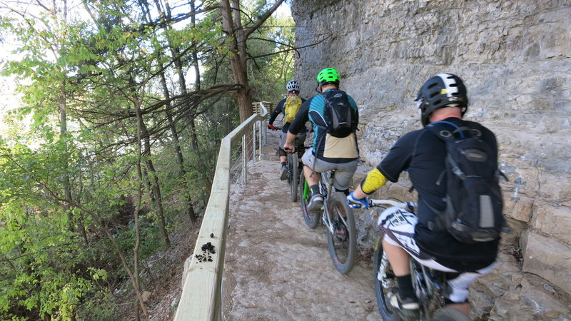"""RIders on the """"Bluff Bridge"""" near Hwy 71.  Notice the extensive rock work."""