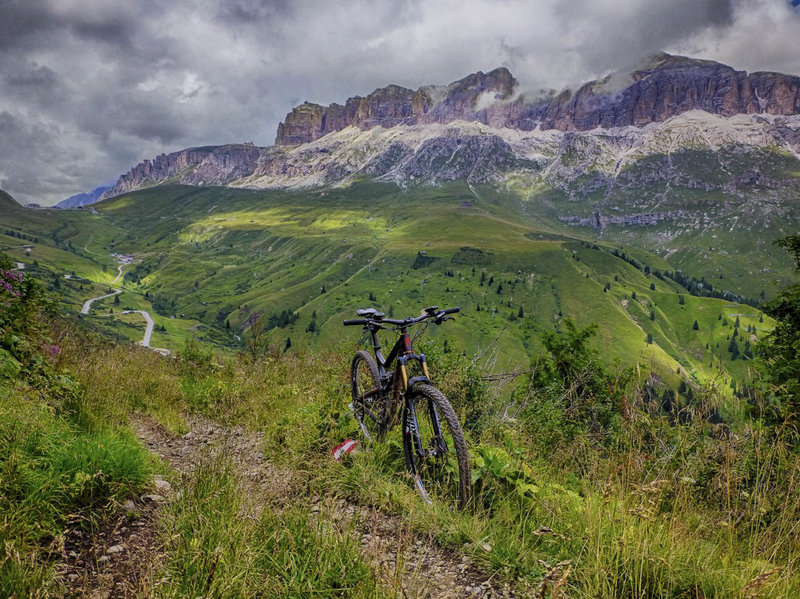 Sweet singletrack on the way to the Passo Pordoi with the Sella Mountain Group in the background.