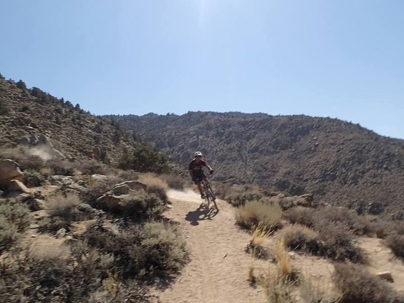 Drifting through some sandy switchbacks on the Coyote Flat Trail heading back to Bishop