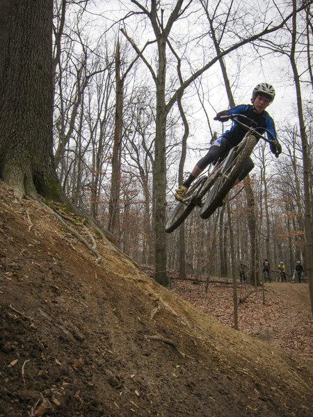 Dylan flying off a hip.