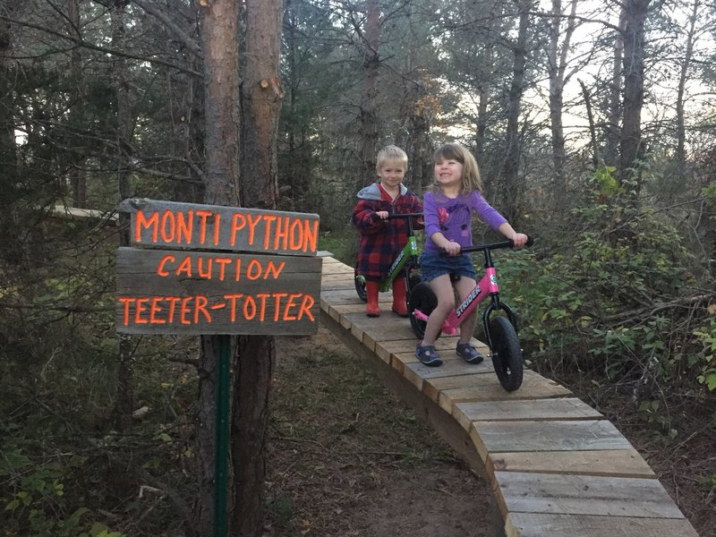 My little ones out on the trail helping me put up a new sign on the 100 ft Monti-Python!