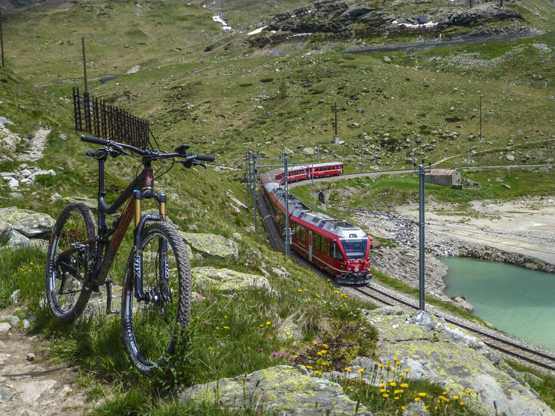 Singletrack paralleling the Bernina Express tracks through the Bernina Pass above Lago Bianco.  On the return trip, try to beat the train back to Samedan from the top of the pass starting from Ospizio Bernina station.