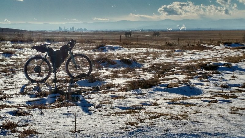 The Denver cityscape stands in the distance along the Rocky Mountain Arsenal Perimeter Trail.