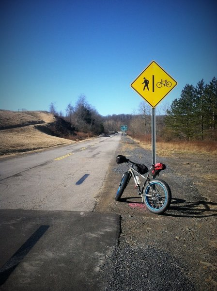 Look for this sign to know you are at the north end (Mitki Power Plant) of the Corridor H Bike Path. Roadside parking is available on the old Route 93 (closed).
