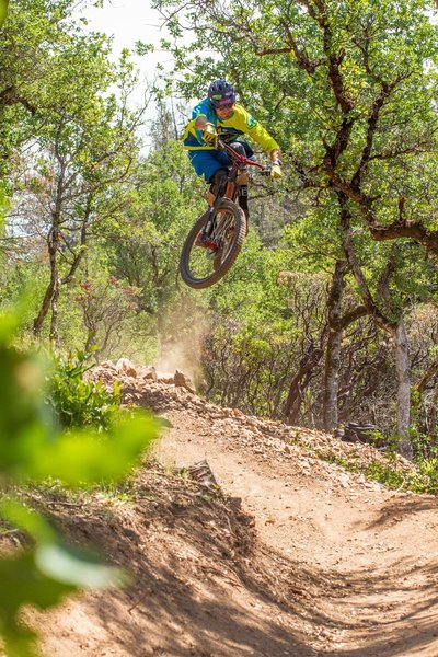 A rider gets rad on the jump on French Fry Trail.