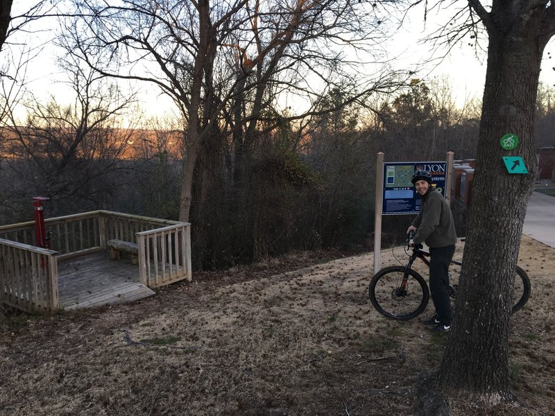 A bike fix-it station and track pump are conveniently located near the trail entry.