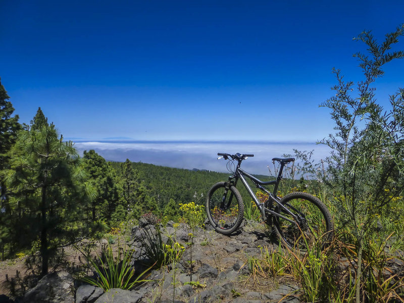 The clouds have erased the Atlantic Ocean a mile below, but you can still see the island of la Palma off in the distance.