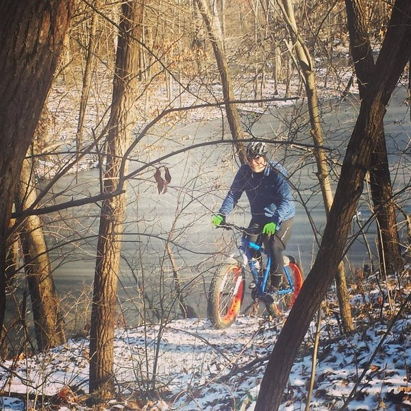 It's all smiles as we fat bike by the frozen pond on Rock and Roll Connector.