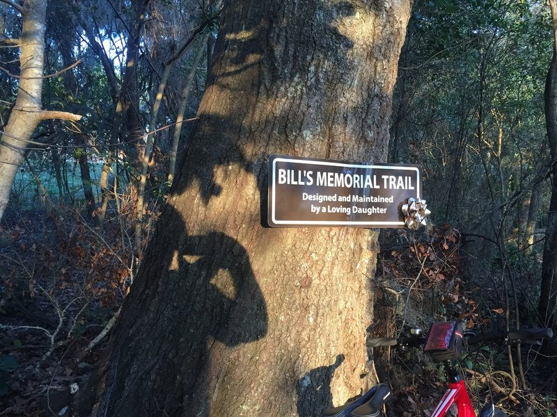 This trail dedication sign alerts all riders to the significance of this trail.