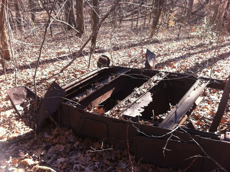 This old Model A chassis rusts alongside the trail - an old car is a requirement on southern Appalachian trails.