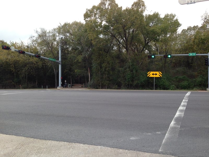 The entrance to Cullen Park Bike and Hike Trail is on the west side of SH 6, as viewed from the parking lot on the northeast corner of the intersection with Patterson Road.