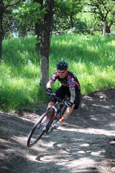 A rider finds air on the Long Creek Trail (taken shortly after construction).