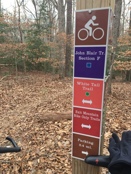 This sign marks the beginning of Section F off the White Tail Trail.