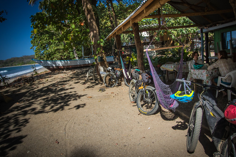Enjoy a great little beach-side soda with hammock chairs and the best salchichon around at the Soda Playa Garza.