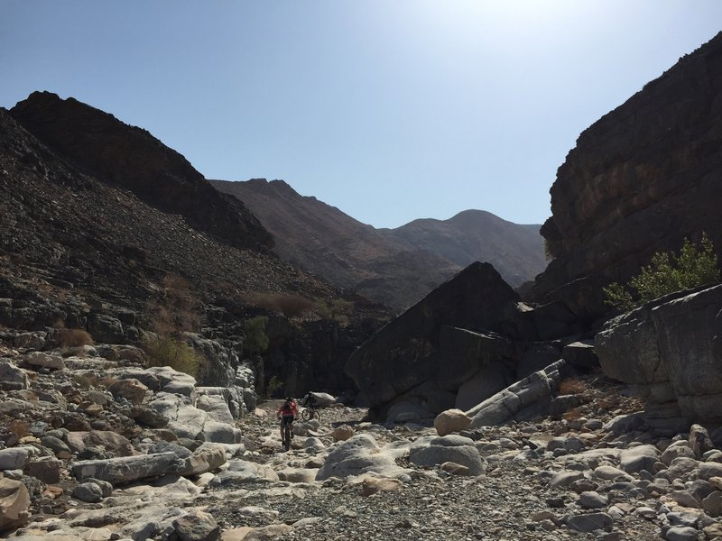 Find the ever-changing line through the boulders in the wadi.