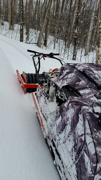 A singletrack groomer turns otherwise soft, awkward trails into great winter riding!