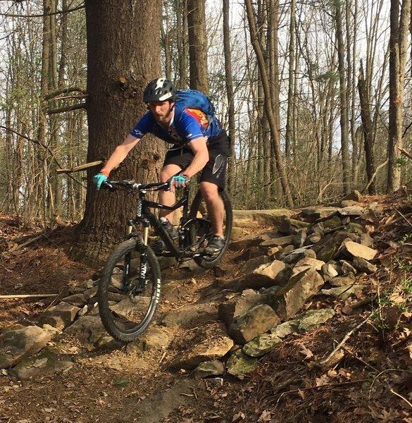 Erin descends rock garden hill on KA-BAR trail.