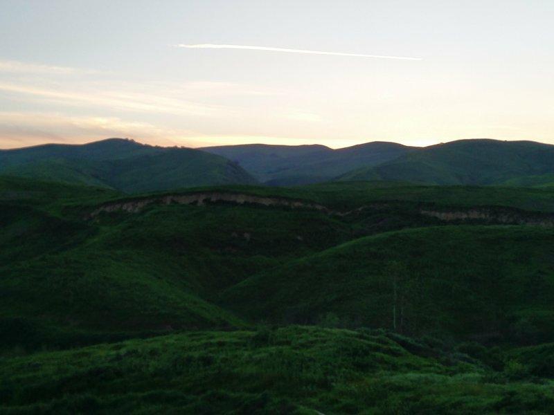 The last glimmer of light streaks across the sky along the South Ridge Trail.