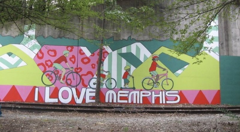 Take in the murals on the side of the trail.