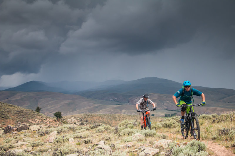 Our group outruns a storm at Hartman Rocks on Graceland, with the Crested Butte Valley in the distance.