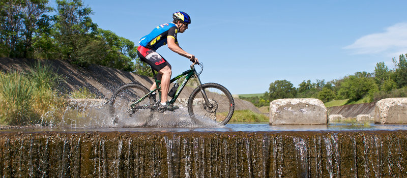 In the spring, the spillway canal on the Meadowlark Trail can make for a wet ride.