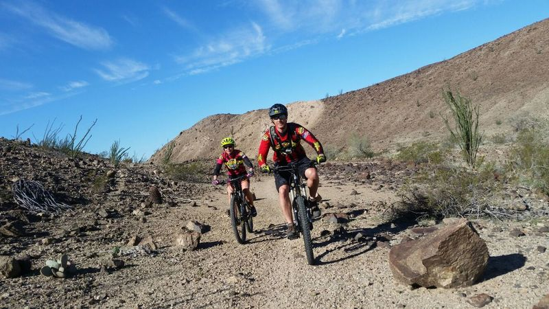 A happy cycling couple gets out for a ride on the Sugarloaf Peak Trails.