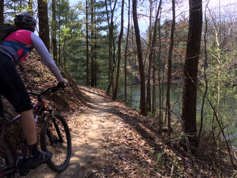 J. rounds a curve while enjoying the view of peaceful Stryker Lake on the East Lake Trail.