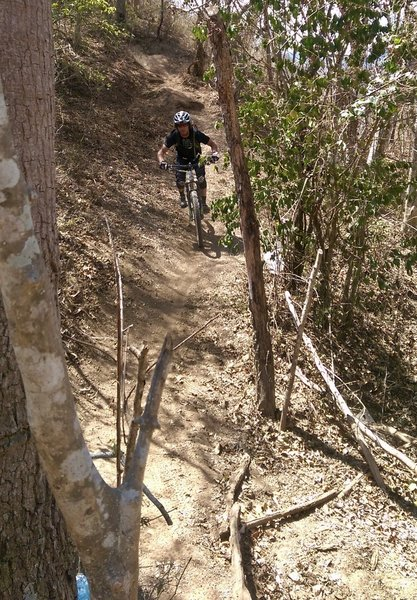 Chaz riding towards another steep descent.