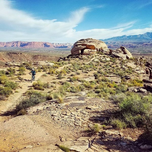 This is such a beautiful and challenging trail! Domelike rock and gorgeous views of St George in the background.