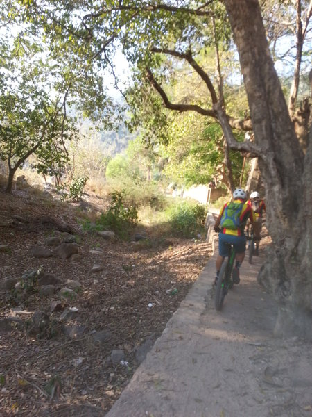 Riding back into town along the river bed.
