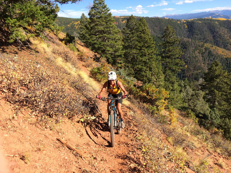 A rider cleans the last technical traverse.