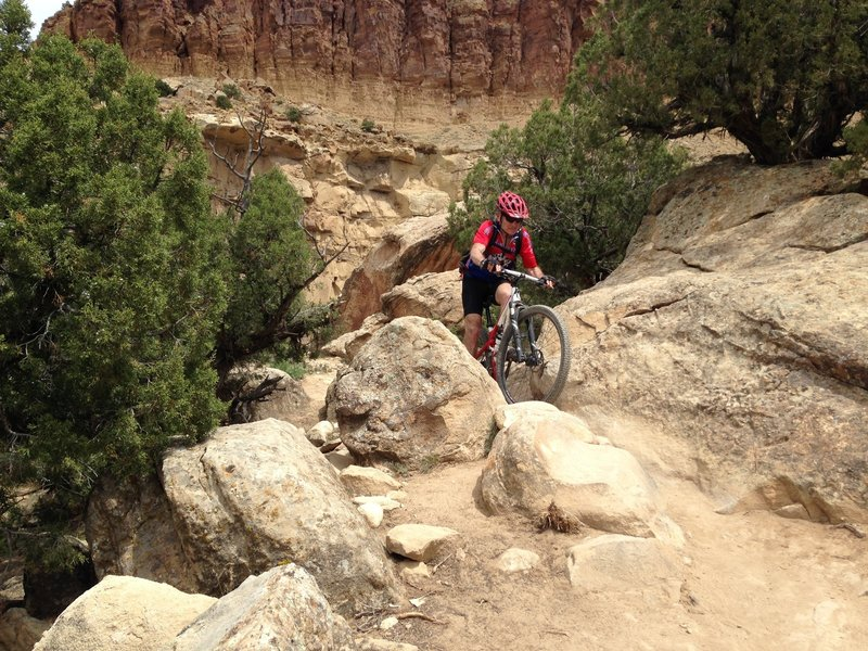 Riding one of the many tech spots on Palisade Rim.