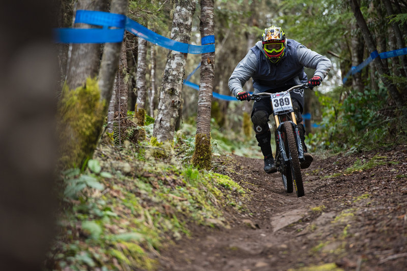 A racer speeds down the sandstone and dirt at the start of Cakewalk.