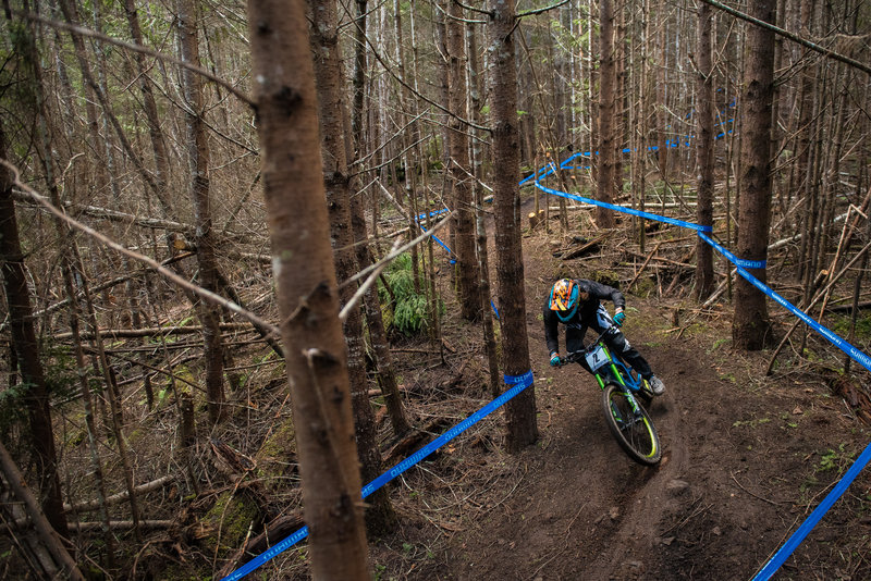 A racer glides between the tape on one of the few level parts of Queen Diamond.