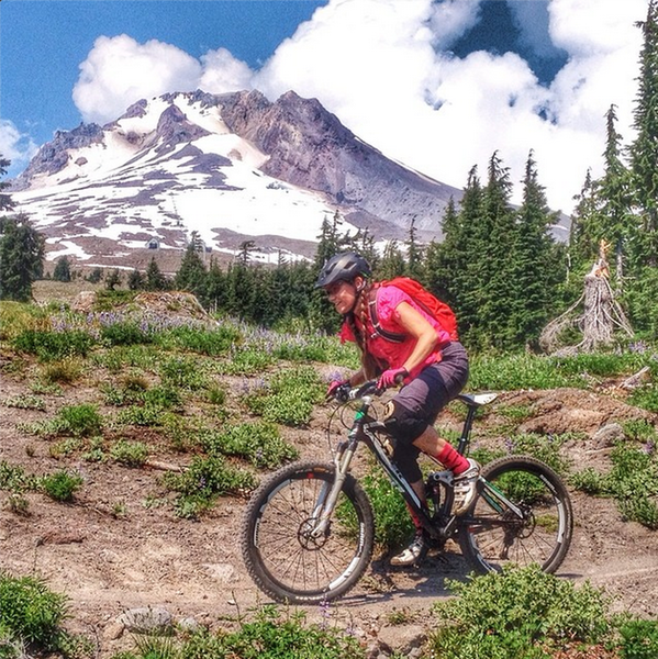 Uma Kleppinger riding below Mt. Hood on the Timberline to Town trail.