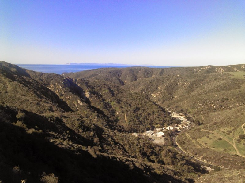 Top of Mathis by the fire hydrant overlooking Laguna Canyon Road with Catalina Island in background.