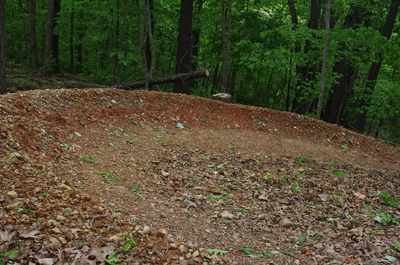 sculpted clay berm on the top section of Flo Ride.